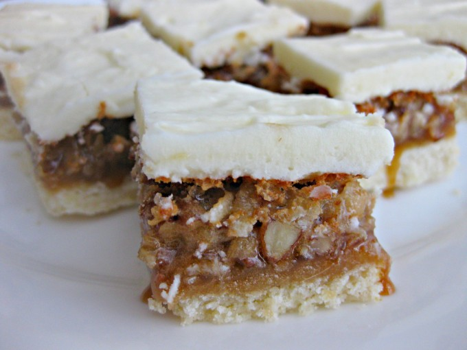 Frosted Pecan Pie Bars RecipeThe only thing that could beat the best pecan pie recipe is frosted pecan pie bars! One of our favorite Thanksgiving desserts is now mini and portable!