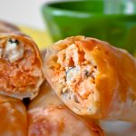Baked Buffalo Chicken Rolls Recipe! Here's the easy step by step guide showing you how to make healthy buffalo chicken rolls with egg roll wrappers, blue cheese, hot sauce, and broccoli slaw! Perfect as an appetizer but they also work as a main meal, too!