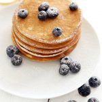 Whole Wheat Pancake Recipe! Unfailingly tender and shockingly fluffy -- this whole grain pancake recipe has a secret ingredient!