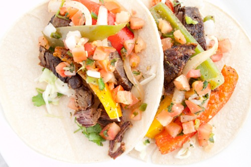 Slow Cooker Steak Fajitas Recipe - this crock pot favorite produces beef fajitas that are fall-apart tender and packed with Mexican flavor!
