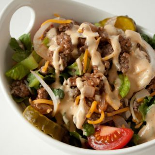 Cheeseburger Salad Recipe with Big Mac Salad Dressing! If you love Big Macs but want something lighter and much healthier, you will love this cheeseburger salad recipe with homemade Big Mac dressing!