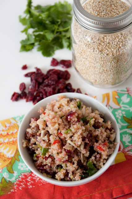 Cranberry Quinoa Salad Recipe! It's loaded with crunchy sunflower seeds, fresh bell peppers, scallions, sweet cranberries, and a honey lemon dressing! 233 calories per serving