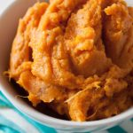 Perfect Mashed Sweet Potatoes Recipe! Add a little cinnamon, ginger, and nutmeg, and prepare to have the best side dish! The recipe can easily be made vegan with coconut oil and unsweetened almond milk. 152 calories per serving! #sidedish #sides #healthy