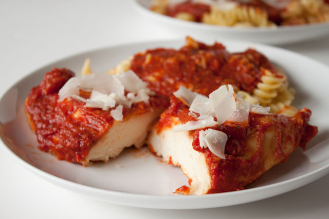 Slow Cooker - Crock Pot Italian Chicken Recipe! Comforting and easy, this crock pot chicken recipe is covered with a quick marinara and turns out tender every.single.time! Perfect for weeknight meals!