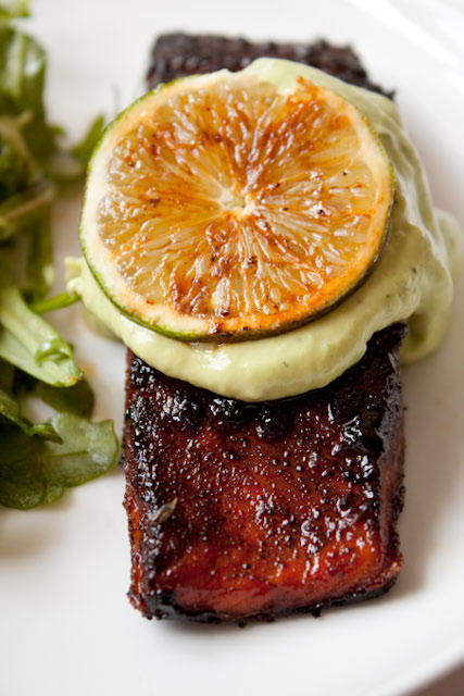 Brown Sugar Chili Rubbed Salmon Recipe - The brown sugar-chili rub gives the salmon a spicy-sweet-smoky flavor that gets blackened in the pan. It's topped with a silky Avocado crema made with lime and garlic that you'll want to slather on just about everything!