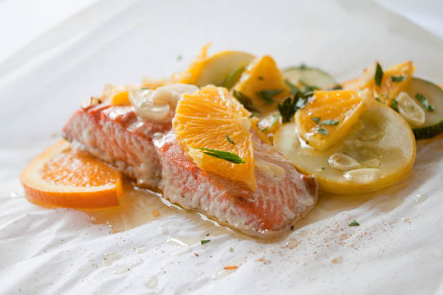 Salmon Baked in Parchment Paper with Orange, Zucchini, and Summer Squash! A healthy salmon recipe that bakes up perfectly tender every single time. Swap out the veggies to whatever you love or whatever's in season!