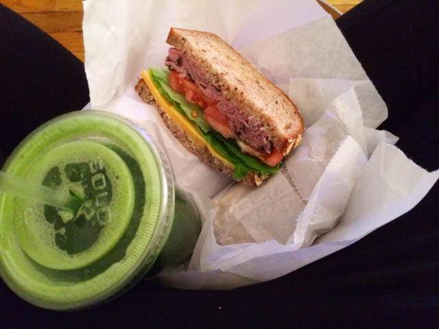 green juice and sandwich