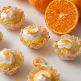 Mini Clementine Cream Tartlets Recipe! A healthier dessert recipe with sunny citrus notes from homemade clementine curd and fresh whipped cream!