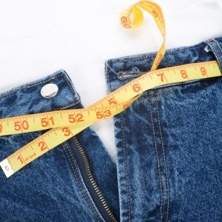a blue jean and ruler, concept of Overweight