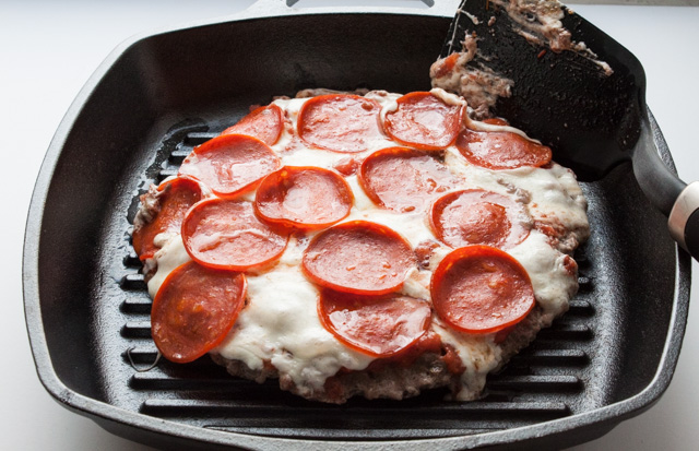 Pepperoni Meatzza Recipe! A low carb pizza recipe made with ground beef topped with fresh mozzarella and pepperoni. It's like big meatball with cheese and sauce - so good!