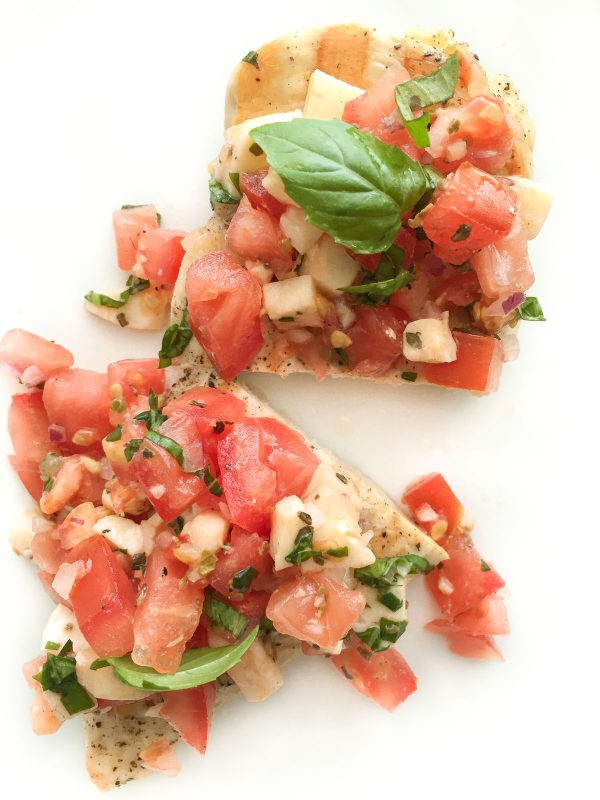 Grilled Chicken with Bruschetta Topping - Forget basic grilled chicken recipes and add flavor with this quick and easy tomato mozzarella bruschetta topping!