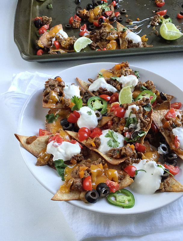 Loaded Healthy Beef Nachos! A homemade healthy beef nachos recipe with baked tortilla chips and all the fixins! Here's a hearty portion of your favorite appetizer for only 374 calories!