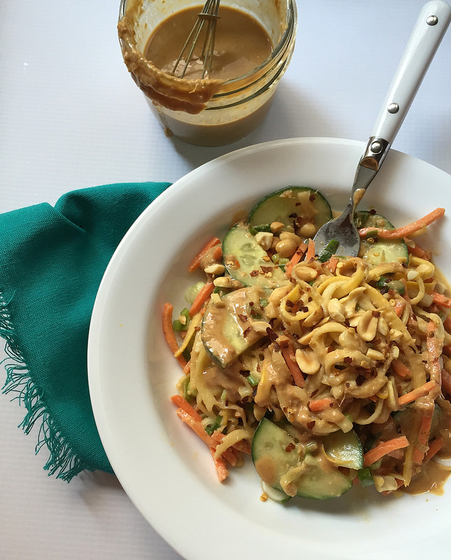 Light and Healthy Peanut Sauce Noodles with Spiralized Summer Squash Noodles - A delicious low-calorie peanut sauce recipe with ginger, garlic, sesame, lime, and a little heat! Pour this over spiralized summer squash noodles for a refreshing cold salad with staying power.