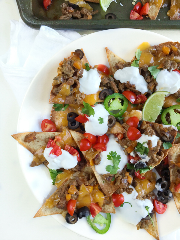 A homemade healthy beef nachos recipe with baked tortilla chips and all the fixins! Here's a hearty portion of your favorite appetizer for only 374 calories!