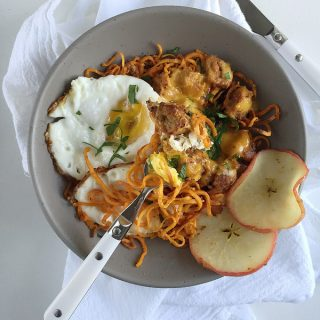 healthy sausage egg and cheese breakfast bowl with curly sweet potato fries