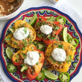 Healthy and Easy Stuffed Peppers with Ground Turkey - loaded with Mexican flavor and tons of veggies! They're made without rice, too, so they're low carb and low calorie!