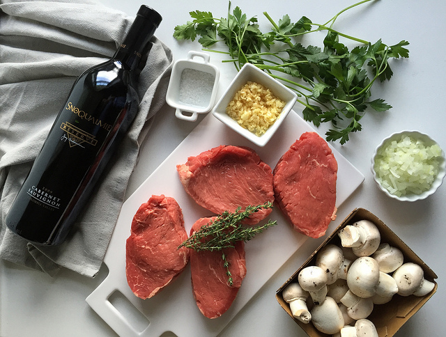 Beef with Red Wine Mushroom Sauce - an easy to prepare beef recipe with restaurant quality appeal and flavor! Just sear tenderloin steaks and saute a thyme-infused mushroom sauce using a dry red wine like cabernet sauvignon