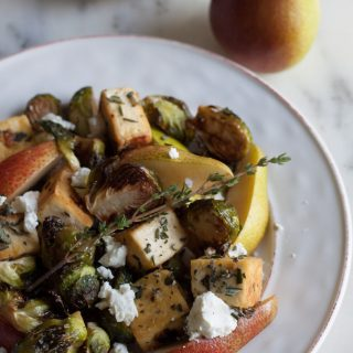 rosemary sage tofu with roasted brussels sprouts pear and goat cheese