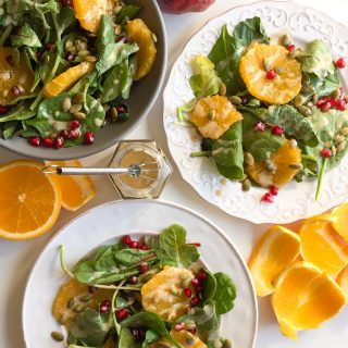 Baby Kale Salad with Orange, Pomegranate, and Maple Tahini Dressing - This gorgeous mix of fall fruits and veggies packs a powerful nutritious punch!