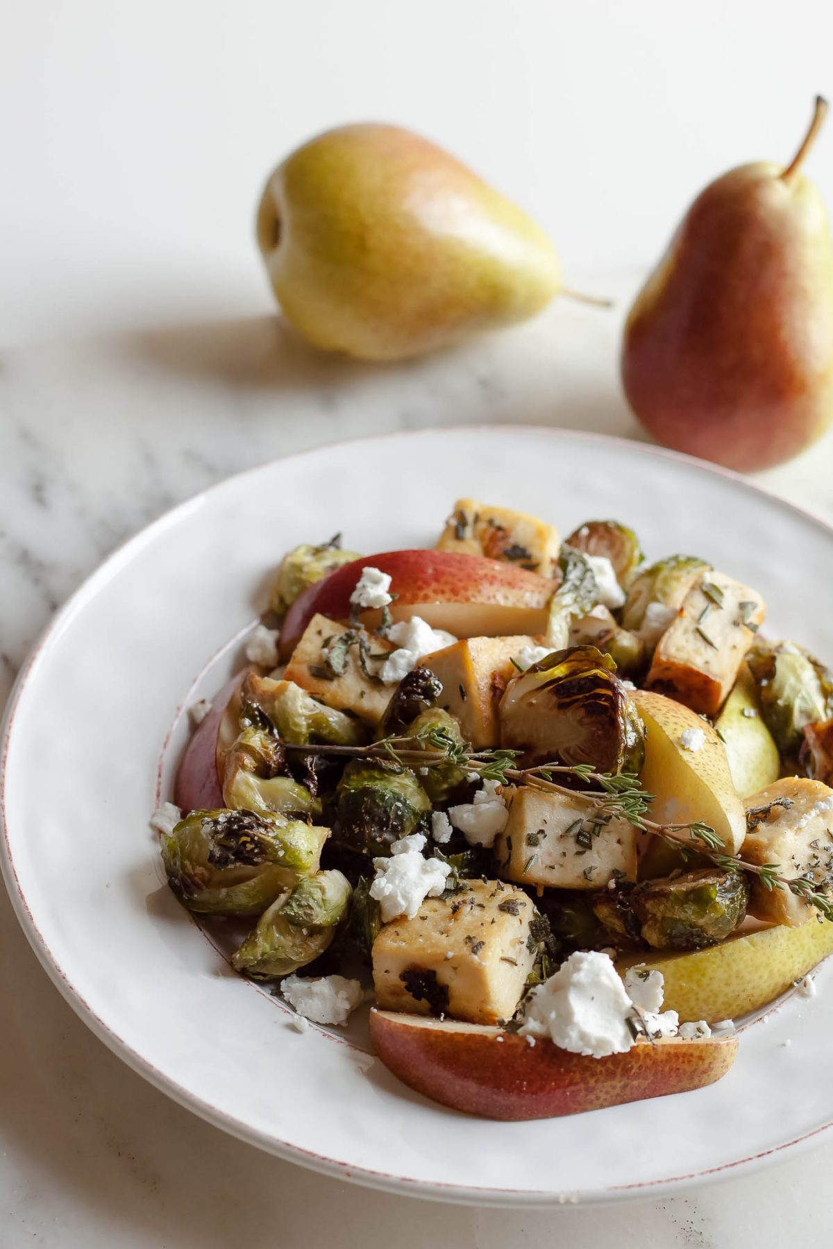Rosemary Sage Tofu with Roasted Brussels Sprouts, Pear, and Goat Cheese - This healthy vegetarian salad recipe is perfect for fall and any holiday table!