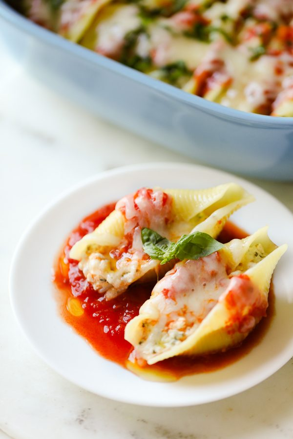 Easy (and Light!) Stuffed Shells Recipe with a secret ingredient to make them low calorie and high protein, too! These are make ahead and freezer friendly!