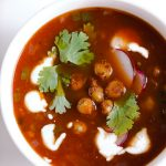 Vegetarian Tortilla Soup Recipe with Chili Roasted Chickpeas! A flavor powerhouse! This vegetarian soup recipe is rich with Mexican flavors like cumin and chili powder, and mildly spicy from sautéed jalapeño pepper. Top the soup with these garlic, oregano, and chili roasted chickpeas to make the soup lighter than traditional versions that have fried tortilla strips, while also boosting the protein and fiber!