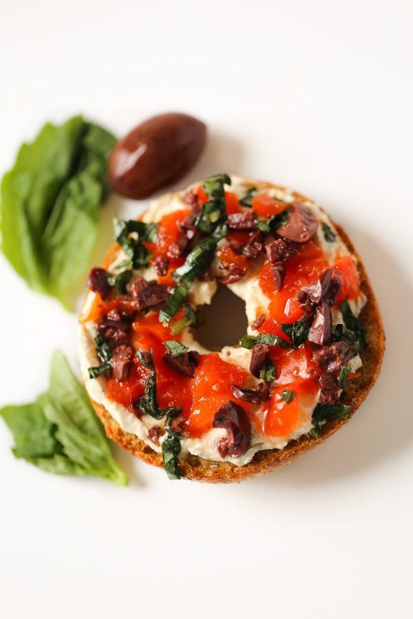 Mediterranean Bagel Spread - 5 Delicious and Light Bagel Toppings - here are 5 delicious bagel spreads you can make with no guilt at all! These toppings include flavors like funfetti, pizza, mediterranean, blueberry coconut, and even chocolate peanut butter banana! All have nutrition information!