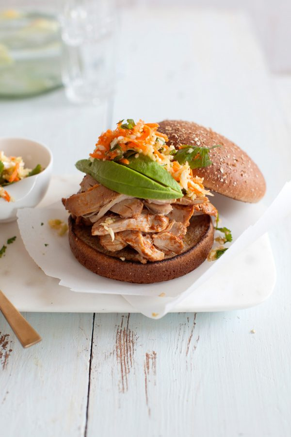 Southwestern Slow Cooker Pulled Chicken Recipe! This easy, unbelievably tender crockpot chicken recipe is sweet, smoky, and just a little spicy - flavored with cumin, chili powder, and coriander! Skip plain old bbq pulled pork or chicken and make this with chicken thighs! Great for a crowd!