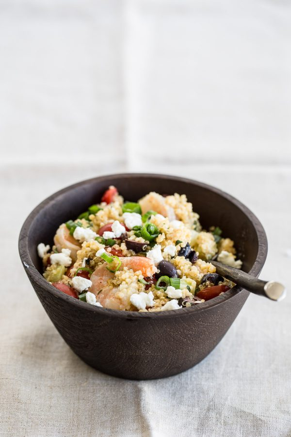 Quinoa Salad with Shrimp, Goat Cheese and Olives! This quick recipe is refreshingly light, healthy, and perfect to make ahead for lunch during the week, or even to bring to a party! It's one of those healthy - hearty salad recipes that can be served hot or cold!