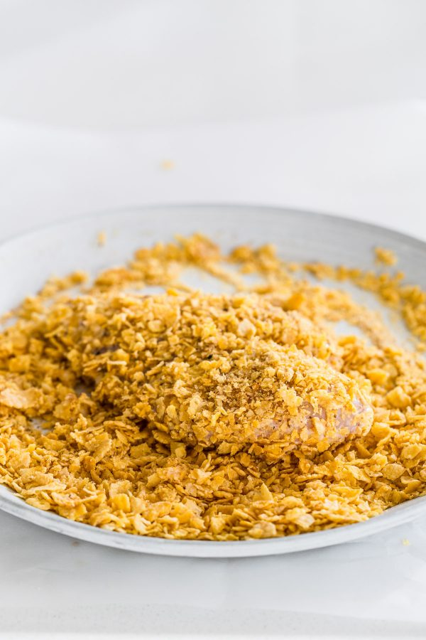 Cornflake Oven Fried Chicken with Honey Mustard Apple Slaw - Lighten fried chicken and keep the flavor! Make this oven fried chicken recipe with crispy seasoned cornflake coating and honey mustard apple slaw!