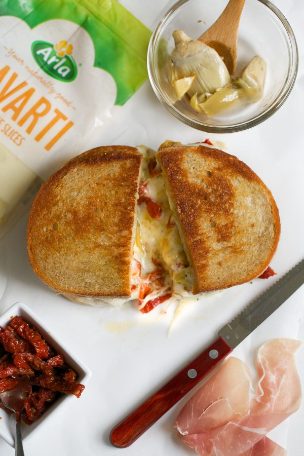 Grilled Cheese with Havarti Sun Dried Tomatoes Prosciutto and Artichokes! This Italian-style grilled cheese sandwich recipe is PACKED with flavor and delicious melty Arla Havarti cheese