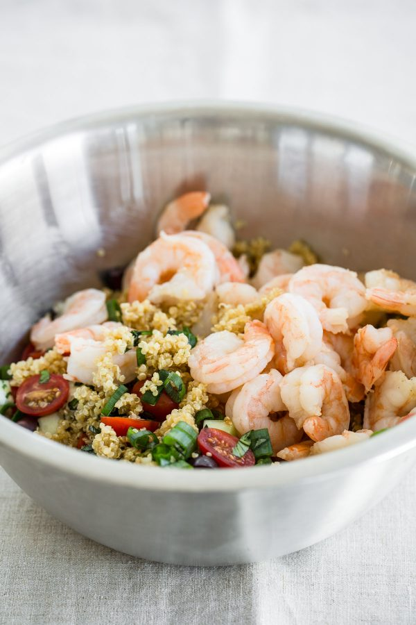 Quinoa Salad with Shrimp, Feta, Tomatoes, and Olives! This recipe is quick to make, refreshing, so light, and perfect to make ahead for lunch or even a party! It's one of those healthy salad recipes that can be served hot or cold!
