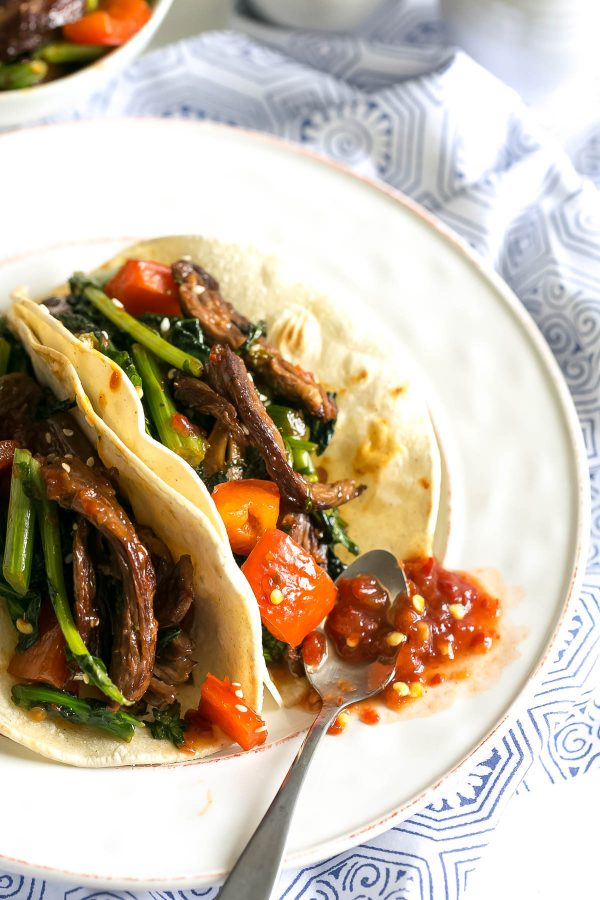 Spicy Beef Tacos Recipe with Broccoli Rabe - marinate your steak in a quick toasted sesame-soy dressing for a flavorful asian fusion taco recipe - paired with superfood broccoli rabe and stuffed in a corn tortilla! An easy weeknight dinner.