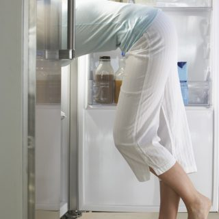 Woman Raiding The Fridge At Night