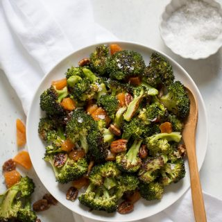 Broccoli salad with apricots and pecans is salty sweet, with roasted broccoli! This recipe is quick and easy to make, has only 5 ingredients, and is great as a potluck side dish.