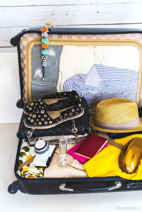 Packed suitcase - photo copyright fotofabrika