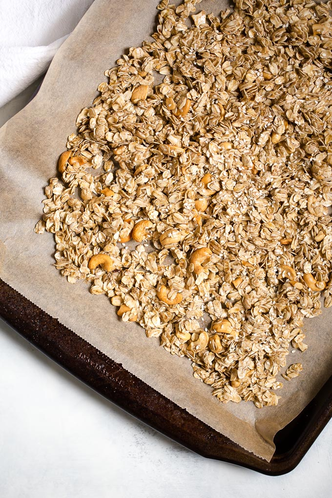 Cashew Ginger Granola with Medjool Dates and Sesame Seeds Recipe - a healthy whole grain granola recipe with cashews, medjool dates, crystallized ginger, sesame seeds, and the warm flavors of cinnamon, allspice and ginger. 295 calories per filling, delicious  serving