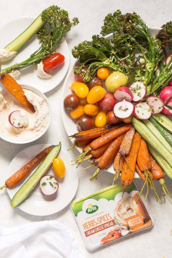How to make a better vegetable platter with recipes for tandoori spice carrots, lemon broccolini, radishes, cucumbers, tomatoes - any seasonal veggies - and an easy cream cheese to dip!