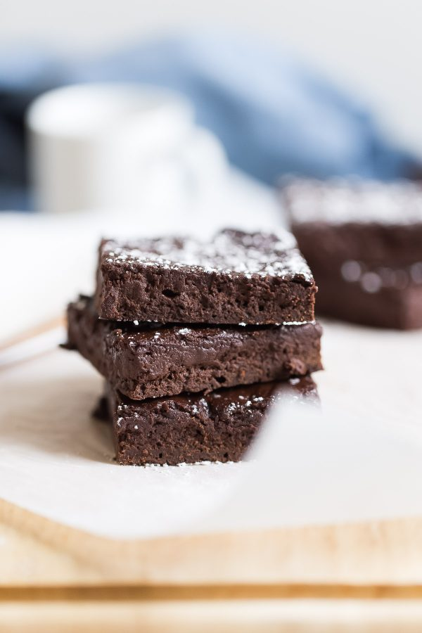 Fudgy 100 Calorie Healthy Brownies - For 100 calories, enjoy fudgy, healthy brownies rich with dark chocolate flavor. Recipe is made with white whole wheat flour, maple syrup, and greek yogurt