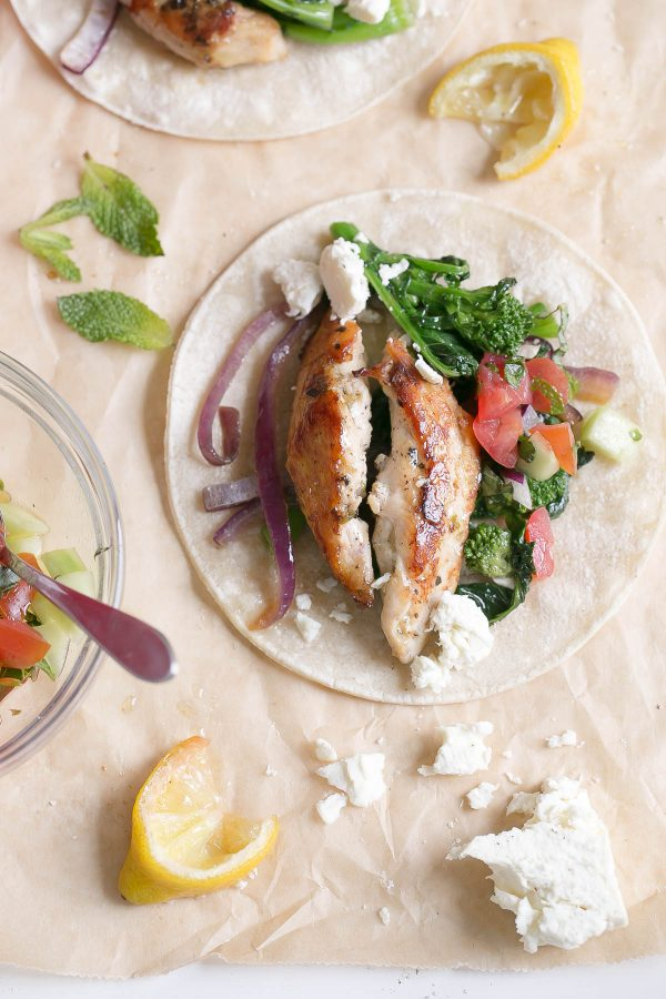 Greek chicken fajitas with broccoli rabe and fresh flavors like lemon, oregano, feta cheese, parsley, and mint. Try this easy weeknight recipe for a Mediterranean spin on traditional fajitas! #broccolirabe
