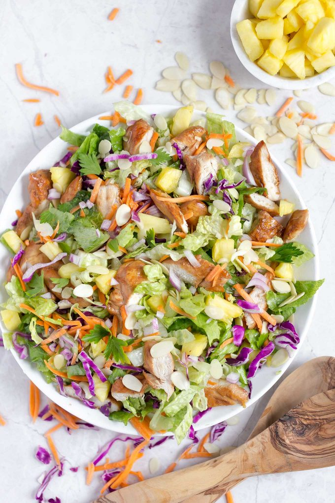 Hawaiian Salad with Pineapple Chicken - This healthy, tropical salad has ginger-soy marinated chicken, pineapple chunks, romaine lettuce, red cabbage, carrots, almonds, and a soy sauce and sesame vinaigrette!