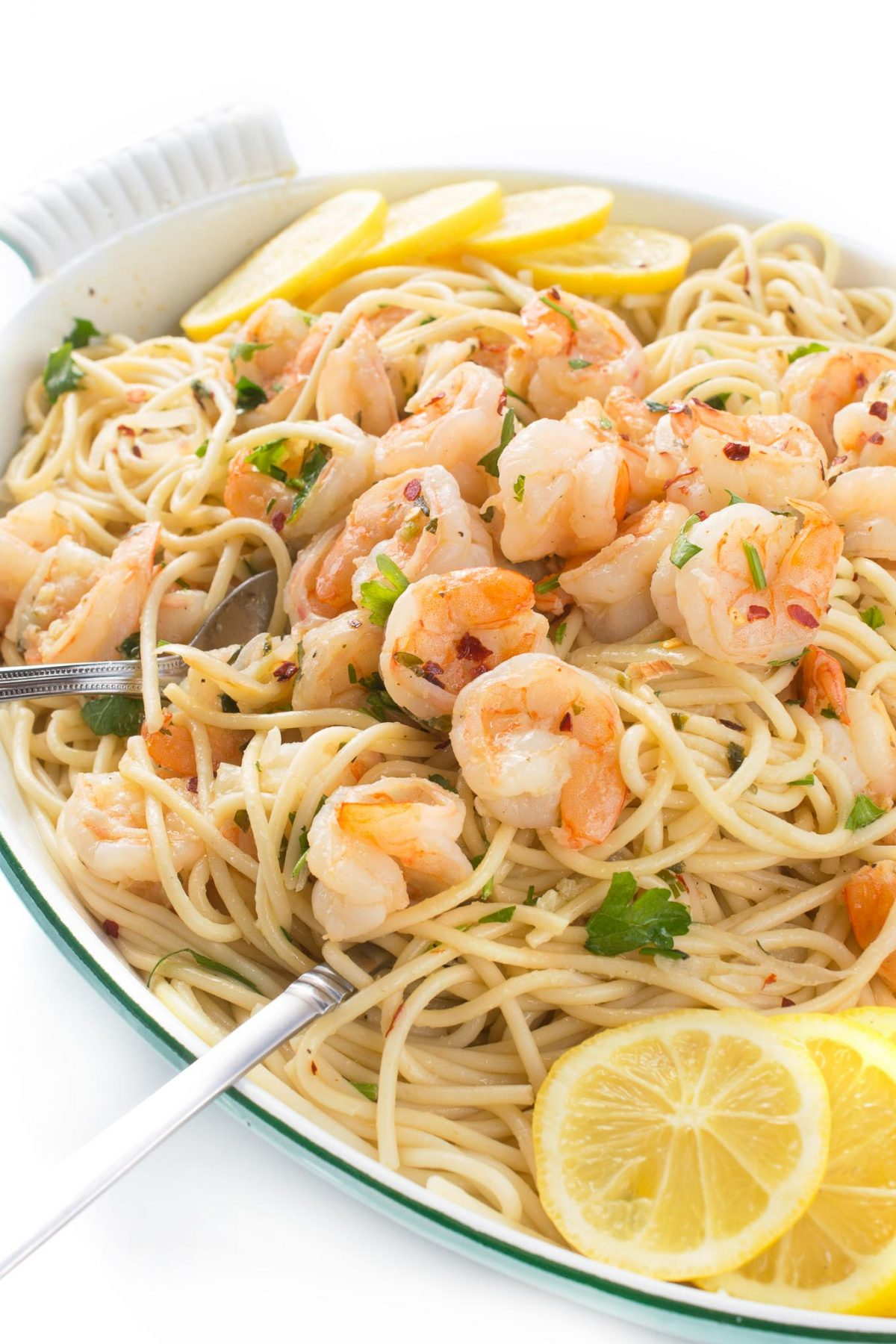 Authentic Shrimp Scampi with Pasta or Zoodles - an authentic Italian recipe with deliciously fragrant garlic shrimp and an easy white wine - butter sauce. 15 minutes to make it! Recipe from Food From Our Ancestors: The Ultimate Italian Sunday Dinner by Liz Della Croce @TheLemonBowl