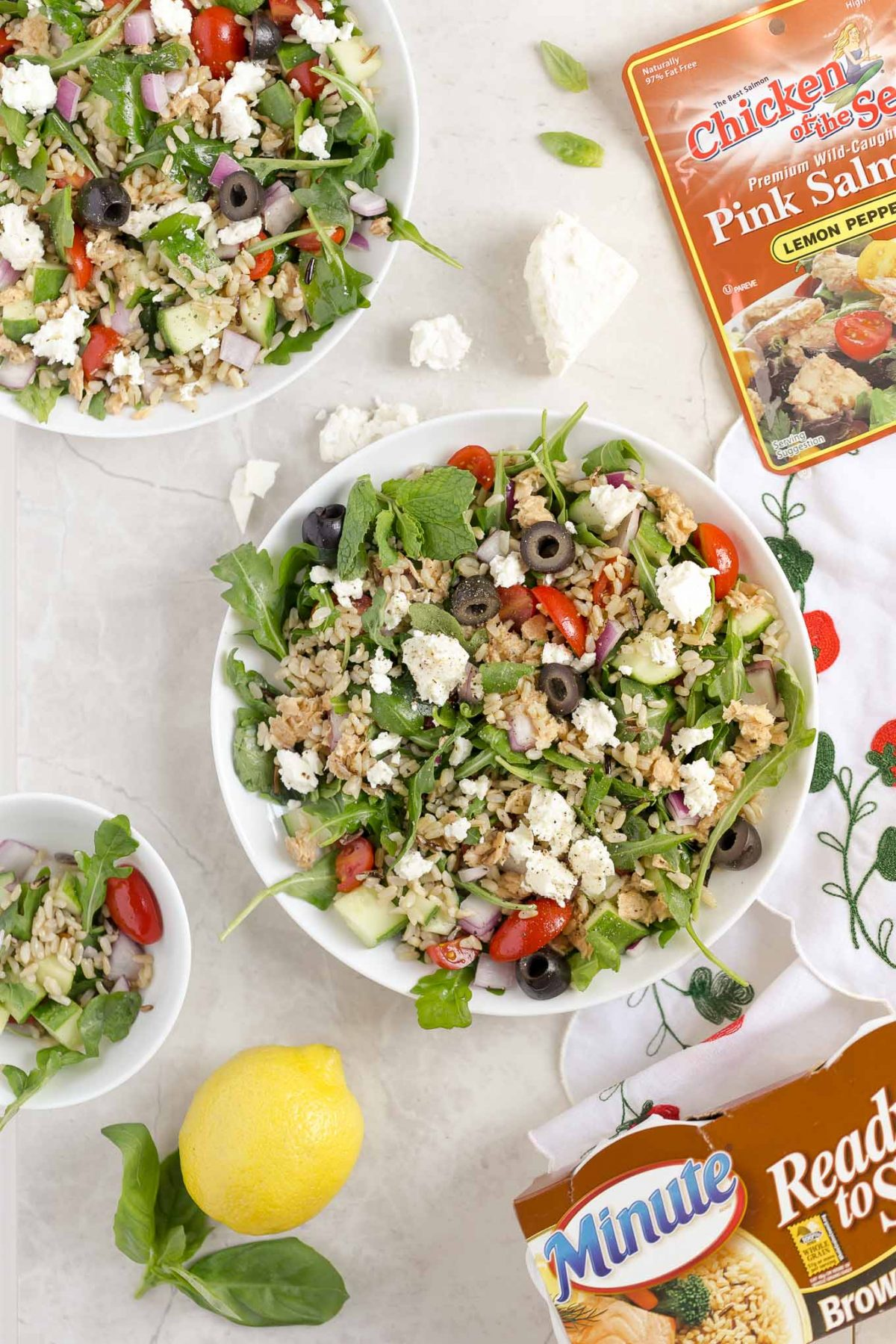 Greek Whole Grain Salad with Lemon Salmon and Feta - A delicious whole grain salad with Greek flavors like feta, olives, lemon pepper salmon, and brown and wild rice! It's quick, easy, and filling!