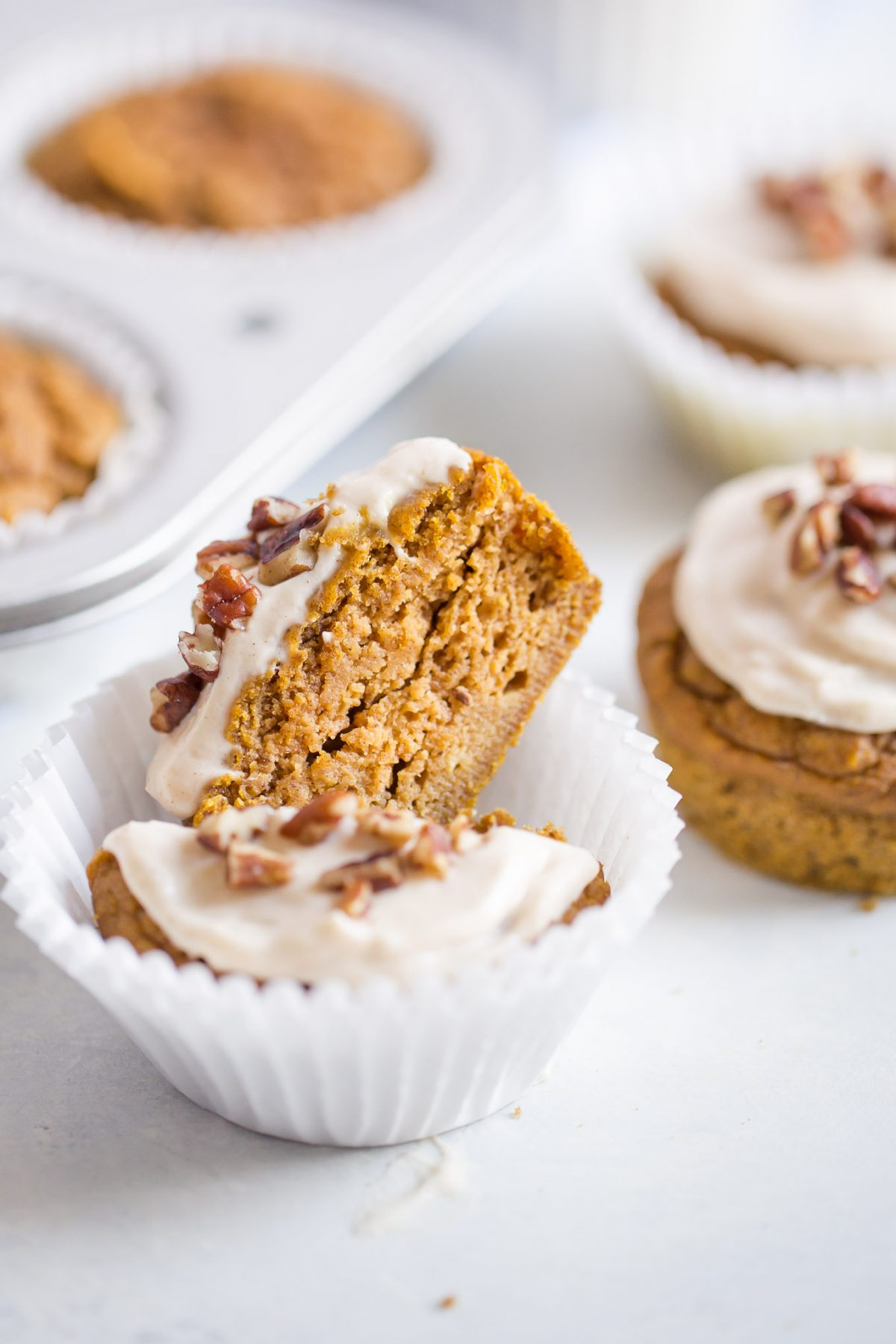 Naturally Sweetened Pumpkin Cupcakes with Maple Cream Cheese Frosting - made with no refined sugar! These are naturally sweetened with medjool date paste!