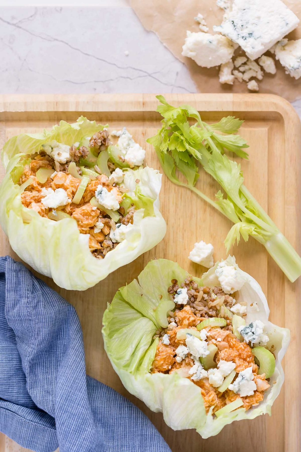 Buffalo Salmon Lettuce Wraps Recipe-A delicious mix of buffalo salmon, crispy celery, multigrain rice, and cool blue cheese inside lettuce wraps! Protein- and fiber-packed, with only 237 cals!