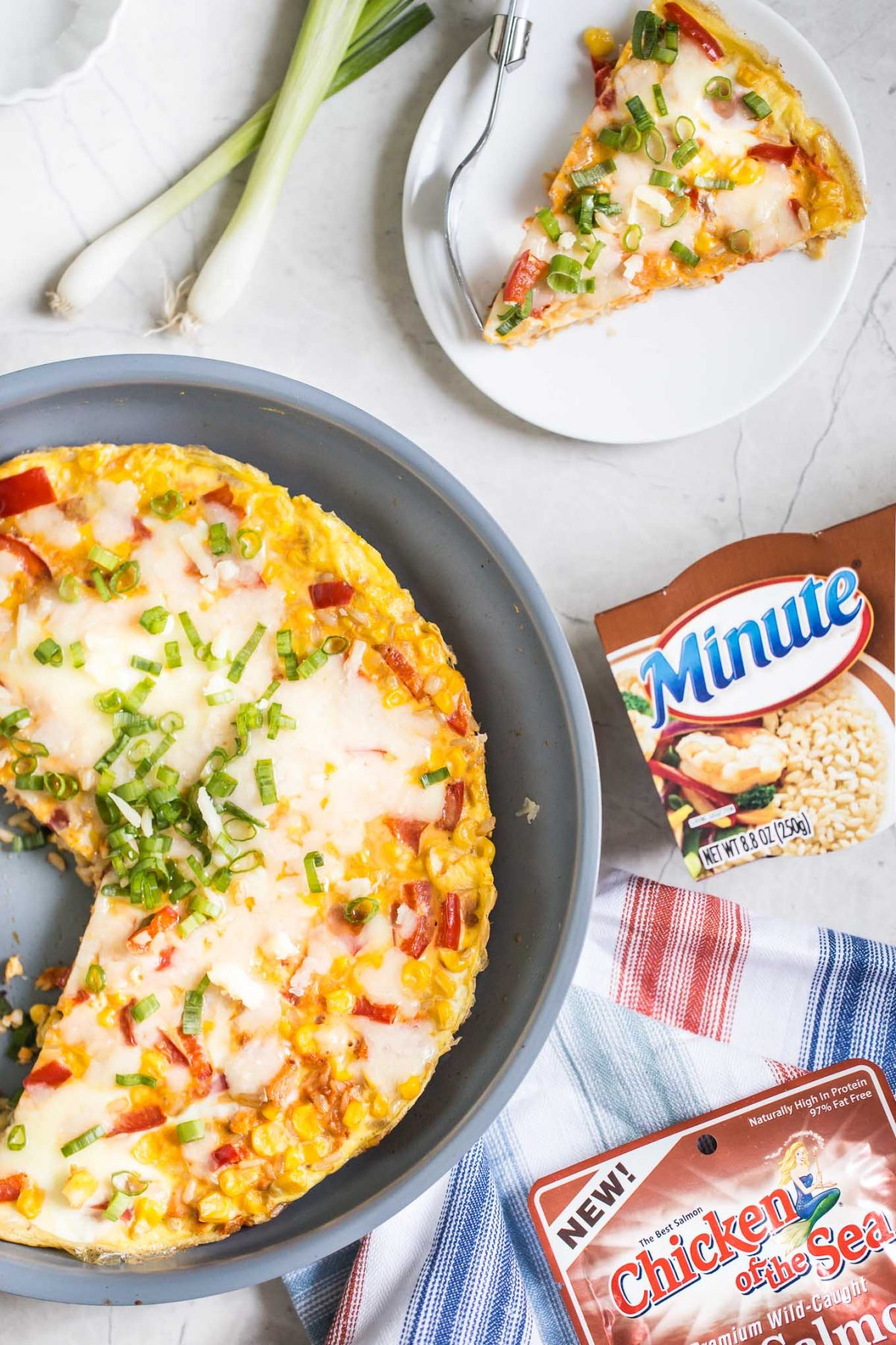 Southwestern Frittata Recipe- Here's how to make an easy breakfast egg frittata recipe with delicious southwestern flavor and plenty of texture! Features red pepper, corn, scallions and cheddar.