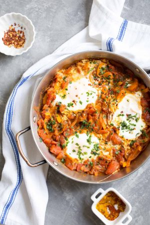 Easy Shakshuka Recipe - an easy and healthy breakfast of eggs simmered in a rich Moroccan spiced tomato sauce!
