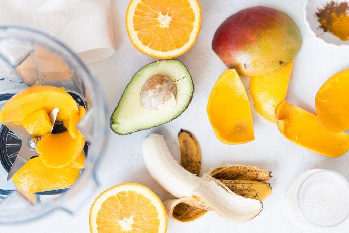 Orange Mango Turmeric Smoothie Bowl Recipe! Made with fresh orange juice, mango, banana, avocado, cinnamon, turmeric, and nutmeg! A healthy and delicious breakfast that's dairy free and vegan