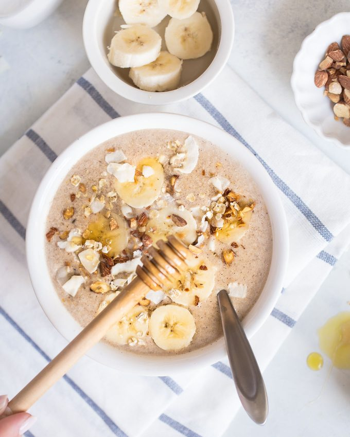 Banana Bread Smoothie Bowl Recipe - made with frozen banana, almond milk, oats, almond butter, cinnamon, and vanilla extract
