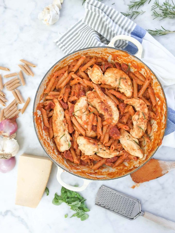 One Pan Rosemary Chicken with Penne and Vodka Sauce - this recipe is made all in one pan with whole wheat penne, broth, and a jar of DeLallo Creamy Vodka Sauce!